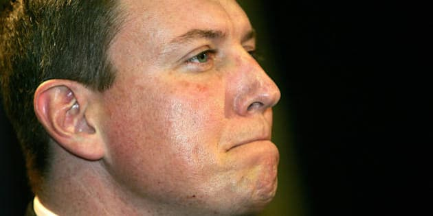 SYDNEY, AUSTRALIA:  New South Wales (NSW) opposition leader John Brogden is seen as he announces his resignation at a press conference in Sydney, 29 August 2005. Brogden resigned after it was revealed that he called Helena, the Malaysian wife of former NSW premier Bob Carr, a 'mail order bride';  pinched the bottom of one female journalist and propositioned another at an alcohol-fuelled party.  AFP PHOTO/Greg WOOD  (Photo credit should read GREG WOOD/AFP/Getty Images)