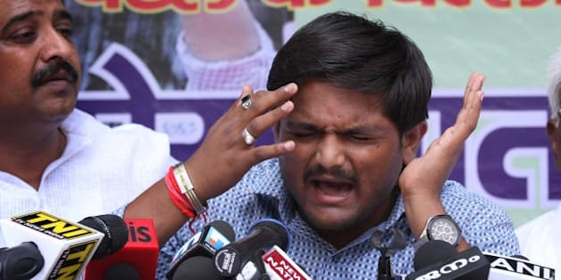 NEW DELHI, INDIA - AUGUST 30: Hardik Patel, Convener of Patidar Anamat Andolan Samiti (PAAS) addresses during a press conference, strongly defended his demand for reservation for Patels or Patidars, saying they are not getting jobs due to reservation, at Press Club, on August 30, 2015 in New Delhi, India. Patel announced that he won't allow any political party to join his agitation and he wants to turn the stir into a national movement. He said, 'We are not here to meet any ministers. Political parties are not welcome in the agitation.' (Photo by Arvind Yadav/Hindustan Times via Getty Images)