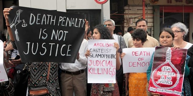MUMBAI, INDIA - JULY 28: Members of Committee for the Protection of Democratic Rights protest as they demand abolishment of death penalty of Yakub Memon at Dadar on July 28, 2015 in Mumbai, India. Yakub, the lone 1993 Mumbai blasts death convict, may not hang on July 30 after the Supreme Court on Tuesday referred a petition challenging his death warrant to a larger bench following a split verdict by a two-judge bench. On Tuesday, Yakub also filed a fresh petition challenging the validity of the SC's July 21 order rejecting his curative petition. Yakub can now be hanged only after the SC rejects his petition - unlikely to happen by July 30, when he is scheduled to be executed at the Nagpur Central Jail, the day he turns 53. Yakub, a chartered accountant and the only well-educated member of the Memon family, was found guilty of criminal conspiracy, arranging money for buying vehicles used by the bombers and organising air tickets to Dubai for some of them. (Photo by Pratham Gokhale/Hindustan Times via Getty Images)