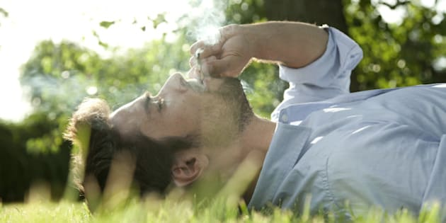 Young man smoking weed outside