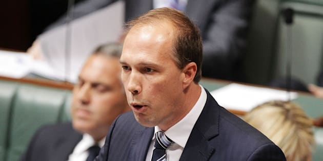 CANBERRA, AUSTRALIA - JULY 15:  MInister for Health Peter Dutton during Question Time at Parliament House on July 15, 2014 in Canberra, Australia. A vote on the Government's Carbon Tax Repeal Legislation has been delayed as debate in the Senate continues. (Photo by Stefan Postles/Getty Images)