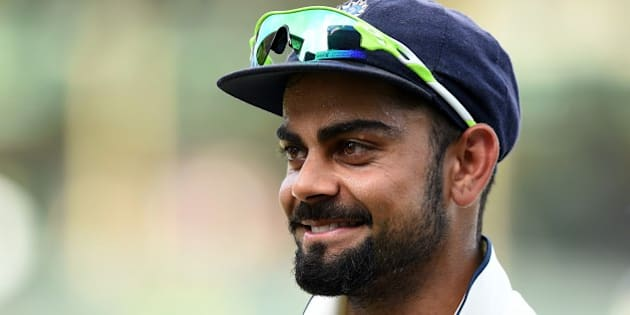 Indian captain Virat Kohli celebrates victory at close of play on the final day of the third and final Test match between Sri Lanka and India at the Sinhalese Sports Club (SSC) in Colombo on September 1, 2015. India defeated Sri Lanka by 117 runs in the third and final Test in Colombo to win a series on the island for the first time since 1993. AFP PHOTO / Ishara S. KODIKARA        (Photo credit should read Ishara S.KODIKARA/AFP/Getty Images)