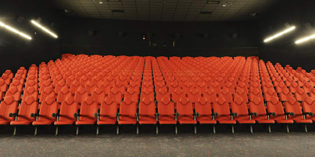 'Front view of large and modern movie theather, wide angle lens'