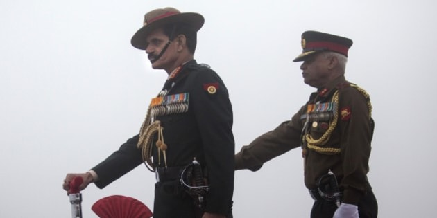 Indian Army Chief General Dalbir Singh Suhag, left, participates in a parade on the occasion of the Indian Army Day in New Delhi, India, Thursday, Jan. 15, 2015. Indian army is one of the largest standing army of the world. (AP Photo/Tsering Topgyal)