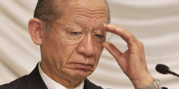 JAPAN - NOVEMBER 15:  Toshiba Corp. Chairman Taizo Nishimuro adjusts his glasses at a press briefing at the 41st Japan-U.S. Business Conference in Tokyo on Monday, November 15, 2004.  (Photo by Michael Caronna/Bloomberg via Getty Images)