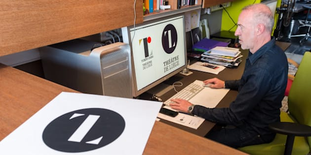 Belgian designer Olivier Debie shows the official emblem for the 2020 Tokyo Olympics and his logo for the Theatre de Liege on a screen in his office in Liege, Belgium, on Friday July 31, 2015.  The designer of the emblem for the Tokyo 2020 Olympics says he did not copy a Belgian theater logo that looks similar. Kenjiro Sano's emblem for the Tokyo games bears a striking resemblance to the logo for Belgium's Theatre de Liege, created by designer Debie. (AP Photo/Geert Vanden Wijngaert)