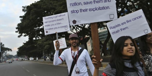 Indian students hold placards during an awareness campaign about safety of women in Bangalore, India, Monday, Dec. 8, 2014, after a woman was allegedly raped by a taxi driver in New Delhi last week. The Indian capital on Monday banned taxi-booking service Uber after a woman accused one of its drivers of raping her. (AP Photo/Aijaz Rahi)