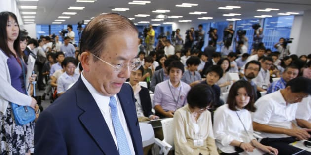 Tokyo 2020 Olympics CEO Toshiro Muto arrives for a press conference in Tokyo, Tuesday, Sept. 1, 2015. Tokyo Olympic organizers are expected to scrap the logo for the 2020 Games on Tuesday following another allegation its Japanese designer might have used copied materials in presentations of the design. (AP Photo/Shizuo Kambayashi)