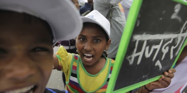 Indian children and freed child laborers participate in a march demanding the passage of the Child and Adolescent Labor (Protection and Regulation) Bill, in New Delhi, India, Thursday, Aug. 29, 2013. The bill if passed would prohibit hazardous work for all children below 18 years and employment of children below 14 years in sync with the Right to Education Act, according to a press release. (AP Photo /Manish Swarup,)