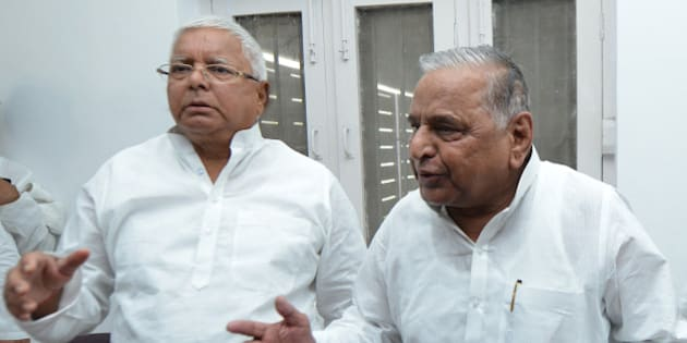 NEW DELHI,INDIA JUNE 08: Samajwadi Party chief Mulayam Singh Yadav and RJD Chief Lalu Prasad Yadav after a press conference regarding JD(U)-RJD alliance for Bihar elections, in New Delhi.(Photo by Praveen Negi/India Today Group/Getty Images)