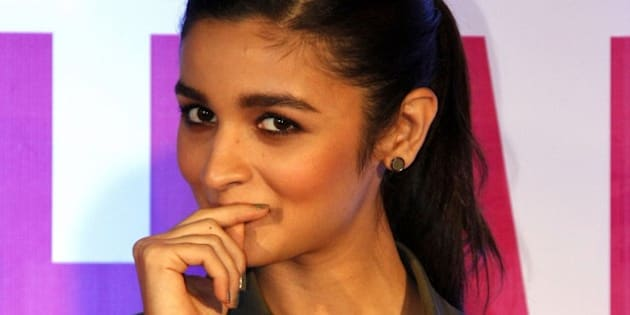 Indian Bollywood actress Alia Bhatt attends the launch of the book Sculpt & Shape: The Pilates Way in Mumbai on August 22, 2015.  AFP PHOTO        (Photo credit should read STR/AFP/Getty Images)