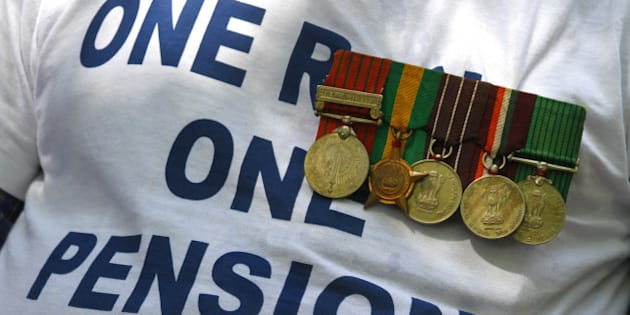 NEW DELHI, INDIA - AUGUST 25: Ex-serviceman with medal participates in a protest over the delay in implementation of One Rank, One Pension (OROP), at Jantar Mantar on August 25, 2015 in New Delhi, India. Col. Pushpender Singh (retd.), who was hospitalised after fasting for nine days over non-implementation of the 'One Rank, One Pension' (OROP), stabilised on but the health of two other veterans deteriorated. (Photo by Virendra Singh Gosain/Hindustan Times via Getty Images)