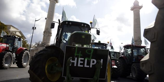 Farmers arrive in Place de la Nation in Paris to take part in a national demonstration on September 3, 2015, in protest at falling prices that they say are endangering their livelihoods. The protest comes after months of unrest as farmers in the dairy and meat industries become increasingly desperate in the face of plummeting food prices which they blame on foreign competition, as well as supermarkets and distributors. KENZO TRIBOUILLARD        (Photo credit should read KENZO TRIBOUILLARD/AFP/Getty Images)