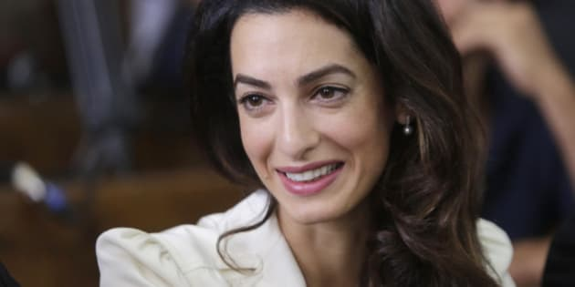 Amal Clooney, a member of the legal team representing Canadian Al-Jazeera English journalist Mohammed Fahmy sits in a courtroom in Tora prison in Cairo, Egypt, Saturday, Aug. 29, 2015. An Egyptian court on Saturday sentenced three Al-Jazeera English journalists to three years in prison, the last twist in a long-running trial criticized worldwide by press freedom advocates and human rights activists. (AP Photo/Amr Nabil)