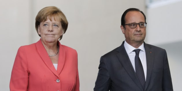 German Chancellor Angela Merkel, right, and French President Francois Hollande arrive for a press statement about the European migrant crisis prior to a meeting at the chancellery  in Berlin, Monday, Aug. 24, 2015. (AP Photo/Markus Schreiber).