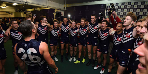 PERTH, AUSTRALIA - AUGUST 30: Ed Langdon of the Fremantle Dockers is showered with sports drink at the team song during the 2015 AFL round 22 match between the Fremantle Dockers and the Melbourne Demons at Domain Stadium, Perth, Australia on August 30, 2015. (Photo by Daniel Carson/AFL Media/Getty Images)