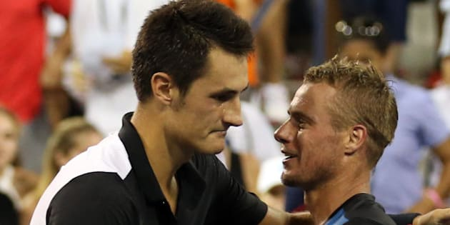 NEW YORK, NY - SEPTEMBER 03:  Bernard Tomic of Australia shakes hands with Lleyton Hewitt of Australia after their Men's Singles Second Round match on Day Four of the 2015 US Open at the USTA Billie Jean King National Tennis Center on September 3, 2015 in the Flushing neighborhood of the Queens borough of New York City.  (Photo by Streeter Lecka/Getty Images)