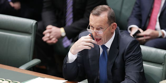 CANBERRA, AUSTRALIA - AUGUST 10: Prime Minister Tony Abbott listens to condolence motions for Donald Randall in the House of Representatives at Parliament House on August 10, 2015 in Canberra, Australia. Bronwyn Bishop resigned as speaker on 3, August following public outcry over travel expenses.  (Photo by Stefan Postles/Getty Images)