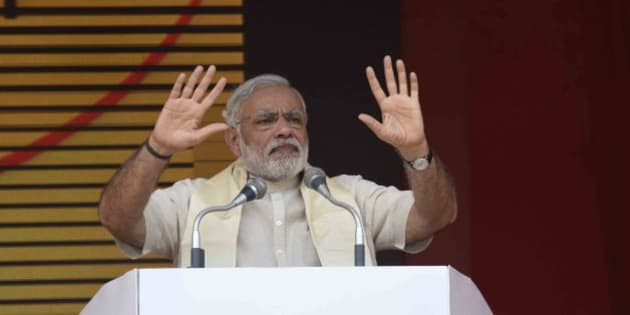ARRAH, INDIA - AUGUST 18: Prime Minister Narendra Modi addresses a public rally on August 18, 2015 in Arrah, India. Prime Minister Narendra Modi announced a package of Rs.1.25 lakh crore for poll bound Bihar. (Photo by Hindustan Times via Getty Images)