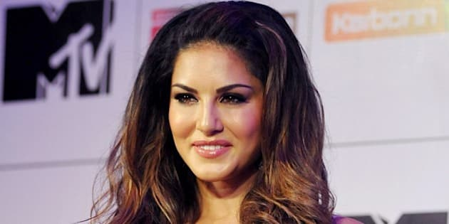 Canadian Bollywood actress Sunny Leone poses as she hosts Indian television reality show MTV Splitsvilla 8 What Women Love in Mumbai late June 30, 2015. AFP PHOTO/STR        (Photo credit should read STRDEL/AFP/Getty Images)