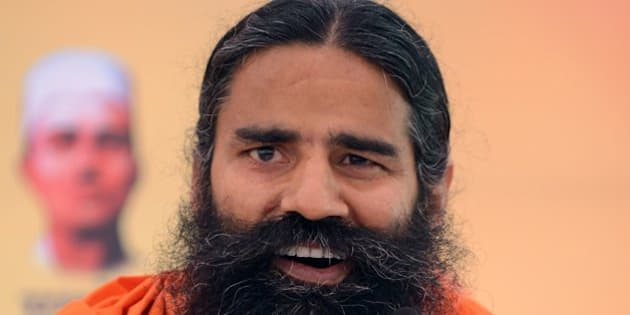 Indian yoga guru Baba Ramdev addresses a press conference in New Delhi on March 21, 2014.   Ramdev will launch a 'Yoga Mahotsav' across India on March 23, with millions of people scheduled to take part in yoga sessions including Bharatiya Janata Party (BJP) Prime Ministerial candidate and Chief Minister of the western Indian state of Gujarat Narendra Modi.    AFP PHOTO/RAVEENDRAN        (Photo credit should read RAVEENDRAN/AFP/Getty Images)