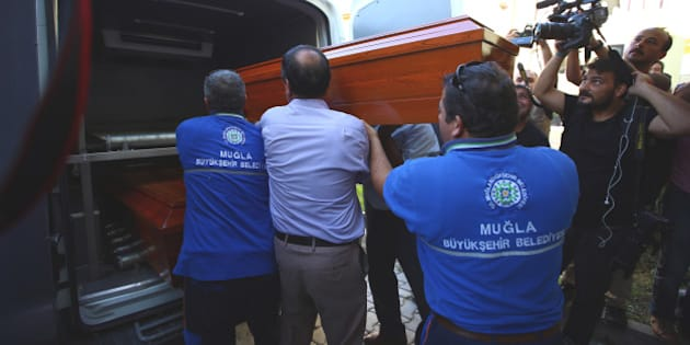 Officials carry the coffin of Rehan Kurdi, the mother of Syrian boys Aylan, 3, and Galip, 5, who were washed up drowned on a beach near Turkish resort of Bodrum on Wednesday, from a morgue to a funeral car in Mugla, Turkey, Thursday, Sept. 3, 2015. Images of Aylan's body on the beach, have heightened global attention to a wave of migration, driven by war and deprivation, that is unparalleled since World War II. (AP Photos/Emrah Gurel)
