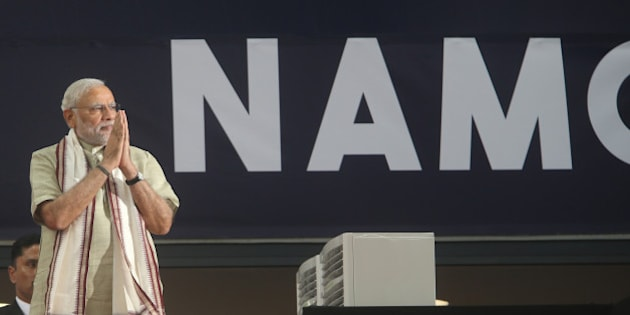 Indian Prime Minister Narendra Modi arrives at a cricket stadium to talk to Indian expatriates, Monday, Aug. 17, 2015, in Dubai, United Arab Emirates. The UAE is home to over two million Indian expatriates and this is the first visit by an Indian premier in over three decades. (AP Photo/Kamran Jebreili)