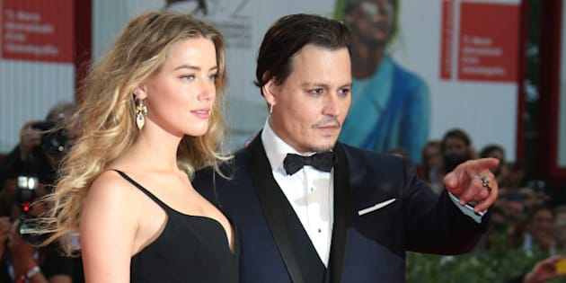 Amber Heard and Johnny Depp pose for photographers upon arrival at the premiere of the film Black Mass during the 72nd edition of the Venice Film Festival in Venice, Italy, Friday, Sept. 4, 2015. The 72nd edition of the festival runs until Sept. 12. (Photo by Joel Ryan/Invision/AP)