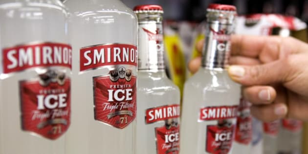 UNITED KINGDOM - FEBRUARY 12:  A customers takes a bottle of Smirnoff Ice, a Diageo product, from the shelf at an off licence, in Hornchurch, U.K., on Thursday, Feb. 12, 2009. Diageo Plc, the world?s biggest liquor maker, signaled it may cut jobs and lowered its profit forecast as demand for Johnnie Walker whisky and Smirnoff vodka stalls, hurt by deteriorating economies around the world.  (Photo by Chris Ratcliffe/Bloomberg via Getty Images)