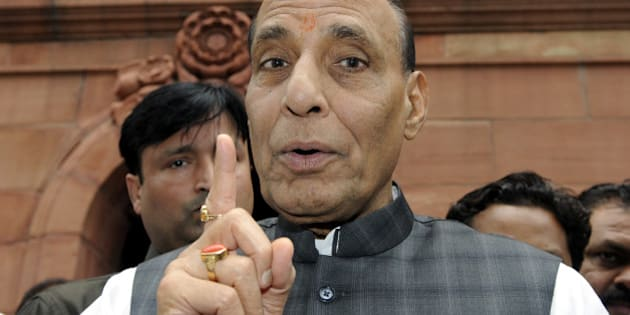 NEW DELHI, INDIA - AUGUST 6: Union Home Minister Rajnath Singh talking with media persons after attending the Parliament Monsoon Session on August 6, 2015 in New Delhi, India. The Lok Sabha passed a bill providing for filing of cheque bounce cases at the places where it is presented. (Photo By Sonu Mehta/Hindustan Times via Getty Images)