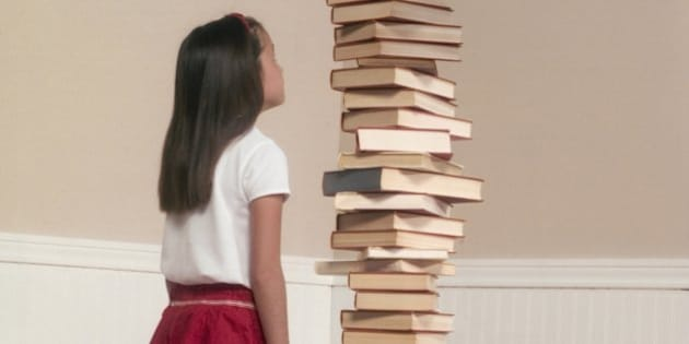 Girl by Stack of Books