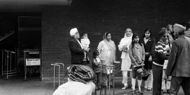 Ugandan Asian refugees arrive at Heathrow Airport after their expulsion from Uganda under the regime of Idi Amin, 1972. (Photo by Charlie Phillips/Getty Images)