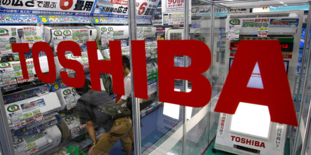 "In this photo taken Monday, July 20, 2015, shoppers look at air conditioners displayed at an electronics store in Tokyo. Toshiba Corp. CEO Hisao Tanaka stepped down Tuesday, July 21, 2015 to take responsibility for doctored books that inflated profits at the Japanese technology manufacturer by 151.8 billion yen ($1.2 billion). Toshiba acknowledged a systematic cover-up, which began in 2008, as various parts of its sprawling business including computer chips and personal computers were struggling financially, but top managers set unrealistic earnings targets under the banner of ""challenge."" (AP Photo/Shizuo Kambayashi)"
