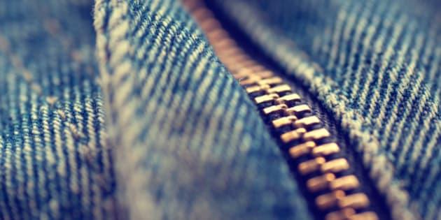 Macro of a  zip on a pair of denim jeans.