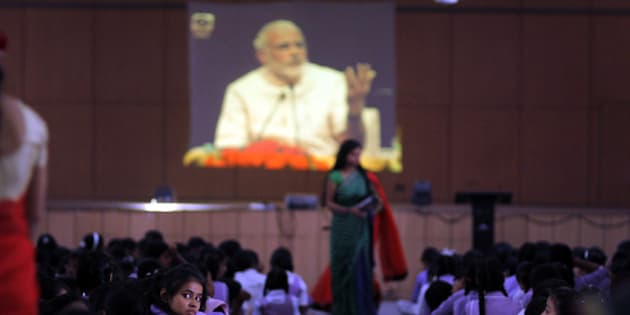 NEW DELHI, INDIA - SEPTEMBER 4: Students watching live telecast of Interaction session of the Prime Minister Narendra Modi with school students on the eve of Teachers Day on September 4, 2015 in New Delhi, India. Addressing students and later replying to their questions via video conferencing in the second such initiative, Modi said he has issued direction to replace 'Character certificates' with Aptitude certificates which will reflect the personality of the students when they leave schools. (Photo by Arun Sharma/Hindustan Times via Getty Images)
