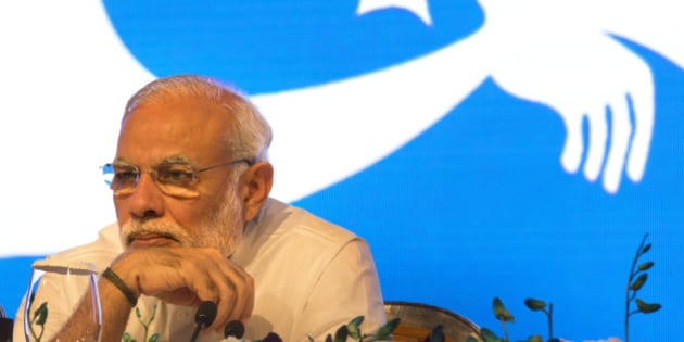 """Indian Prime Minister Narendra Modi attends the Call To Action Summit 2015, """"Ending preventable child and maternal deaths"""", in New Delhi, India, Thursday, Aug. 27, 2015. Promising to provide equitable healthcare that addresses intra-state disparities, Modi listed out achievements and strides made by India especially in materal and child health Thursday. He also said that India would reach close to achieving the millennium development goal of reducing under-five mortality rate, according to Press Trust of India. (AP Photo/Manish Swarup)"""