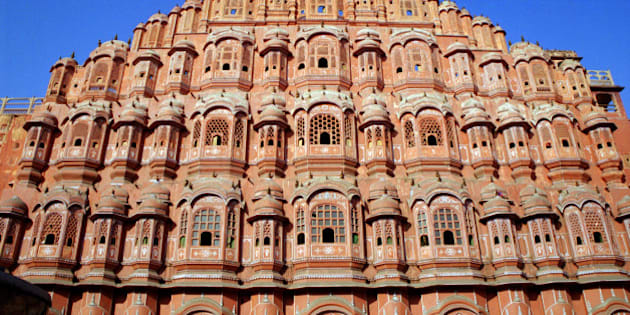 """From Wikipedia: <a href=""""http://en.wikipedia.org/wiki/Hawa_Mahal"""" rel=""""nofollow"""">en.wikipedia.org/wiki/Hawa_Mahal</a>  Hawa Mahal (Hindi: हवा महल, translation: """"Palace of Winds"""" or """"Palace of the Breeze""""), is a palace in Jaipur, India. It was built in 1798 by Maharaja Sawai Pratap Singh, and designed by Lal Chand Ustad in the form of the crown of Krishna, the Hindu god. Its unique five-storey exterior is also akin to the honeycomb of the beehive with its 953 small windows called jharokhas that are decorated with intricate latticework.[1] The original intention of the lattice was to allow royal ladies to observe everyday life in the street below without being seen, since they had to observe strict """"purdah"""" (face cover). Besides this, the lattice also provides cool air caused by the Venturi effect (doctor breeze) through the intricate pattern and thereby air conditioning the whole area during the high temperatures in summers. [1][2][3]  Built of red and pink sandstone, the palace is situated on the main thoroughfare in the heart of Jaipur's business centre. It forms part of the City Palace, and extends to the Zenana or women's chambers, the chambers of the harem. It is particularly striking when viewed early in the morning, lit with the golden light of sunrise.   <a href=""""http://www.flickriver.com/photos/enjosmith/popular-interesting/"""" rel=""""nofollow"""">enjosmith's most interesting photos on Flickriver</a>"""