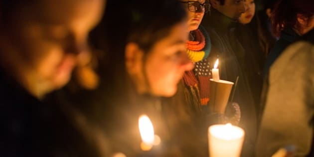 MELBOURNE , AUSTRALIA - SEPTEMBER 07: Melbournians holding candles during a candle light vigil in honour of Syrian refugee Aylan Kurdi and in protest against the Australian government's position on refugees and asylum seekers on September 07, 2015, in Melbourne, Australia. (Photo by Asanka Brendon Ratnayake/Anadolu Agency/Getty Images)