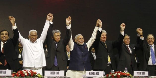 From Left to right, Reliance Industries Limited Chairman Mukesh Ambani, former Gujarat finance minister Vajubhai Vala, Ambassador of Japan to India Takeshi Yagi, Gujarat Chief Minister Narendra Modi, High Commissioner of Canada to India Stewart Beck, retired Chairman of Tata group Ratan Tata and British High Commissioner to India James Bevan hold and raise their hands as they pose for photographs during the inauguration of the 6th Vibrant Gujarat Global Summit (VGGS) in Gandhinagar, India, Friday, Jan. 11, 2013. Vibrant Gujarat Global Summit is a biennial gathering for discussion and action on emerging business opportunities in Gujarat and beyond. (AP Photo/Ajit Solanki)