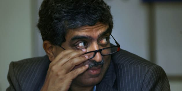 Nandan Nilekani, left, Chairperson Unique Identification Authority of India, a new government office that plans to issue national identity cards to all 1.2 billion Indian citizens, looks on during an event in New Delhi, India, Thursday, July 16, 2009. (AP Photo/Manish Swarup)