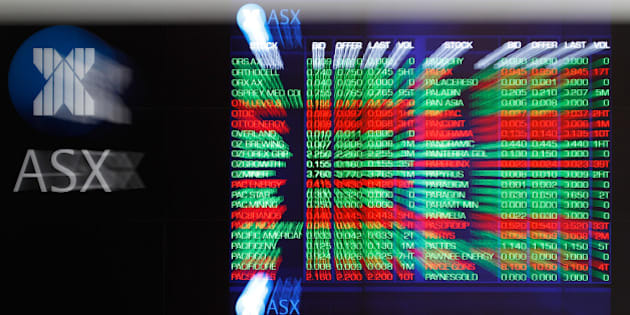 Stock information is displayed on an electronic board inside the Australian Securities Exchange, operated by ASX Ltd., in Sydney, Australia, on Friday, July 24, 2015. The Australian dollar slumped last week as a gauge of Chinese manufacturing unexpectedly contracted, aggravating the impact of declines in copper and iron ore prices. Photographer: Brendon Thorne/Bloomberg via Getty Images