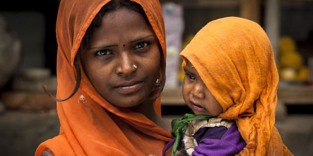 Women Face: Mother and her son in Sadari rural village -  India