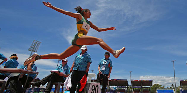 APIA, SAMOA - SEPTEMBER 08:  Billie Arch of Australia jumps as she competes in the Girls Long Jump during the Athletics at the Apia Park Sports Complex on day two of the Samoa 2015 Commonwealth Youth Games on September 8, 2015 in Apia, Samoa.  (Photo by Scott Barbour/Getty Images)