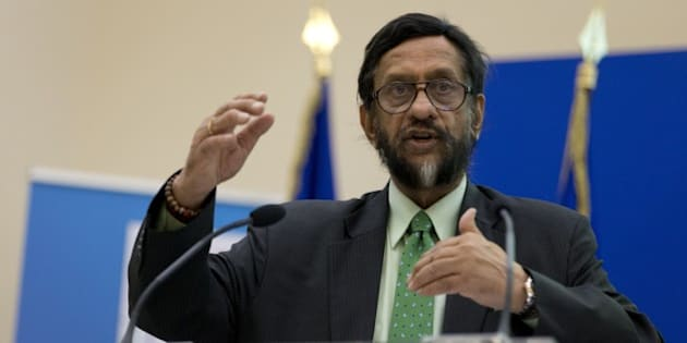The head of the UN's climate science panel (Intergovernmental Panel on Climate Change - IPCC) Rajendra Pachauri speaks during a climate conference in Paris on November 5, 2014.  AFP PHOTO / KENZO TRIBOUILLARD        (Photo credit should read KENZO TRIBOUILLARD/AFP/Getty Images)