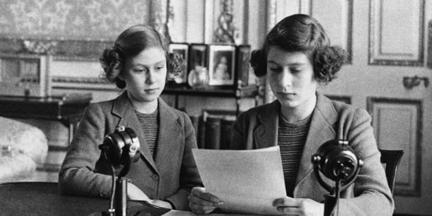 In her first radio broadcast, 14-year-old Princess Elizabeth, right, said that England's children at home were full of cheerfulness and courage. She is shown with her younger sister, Princess Margaret Rose, before the broadcast, in London on Oct. 13, 1940. (AP Photo)