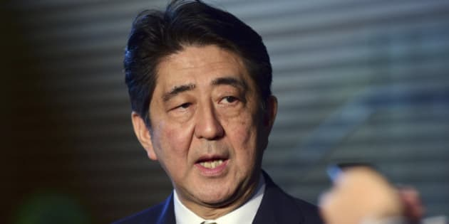 Japanese Prime Minister SHinzo Abe speaks to reporters at his official residence in Tokyo Tuesday, Sept. 8, 2015. Abe has won a new term as president of the ruling Liberal Democratic Party after facing no opposition for the job. (Yoshikazu Tsuno/Pool Photo via AP)
