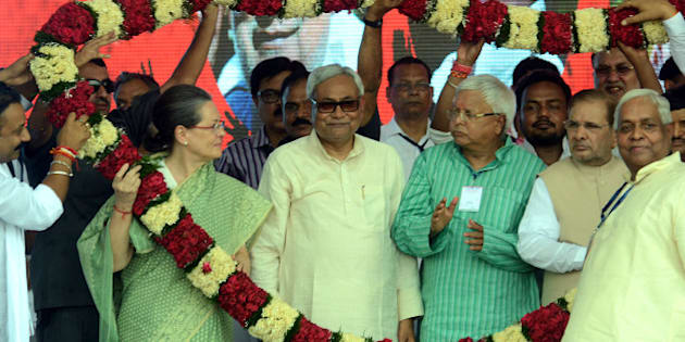 PATNA, INDIA - AUGUST 30: Congress President Sonia Gandhi with Bihar Chief Minister Nitish Kumar and RJD Chief Lalu Prasad during the Swabhiman rally at Gandhi Maidan, on August 30, 2015 in Patna, India. Gandhi attacked Modi on national level issues - his 'failure' to provide jobs to the youth, his 'anti-farmer' land bill, which he is now set to withdraw under Opposition from the Congress and the 'communal' agenda of the ruling BJP. (Photo by Santosh Kumar/Hindustan Times via Getty Images)