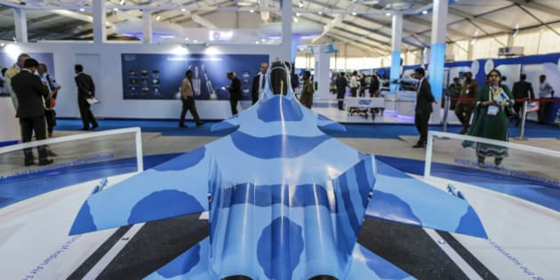 A model of the Sukhoi Su-30MKI fighter jet, a project by BrahMos Aerospace Pvt, a joint venture between Defence Research and Development Organisation (DRDO) of India and Military Industrial Consortium NPO Mashinostroyenia of Russia, stands on display during the Aero India air show at Air Force Station Yelahanka in Bengaluru, India, on Thursday, Feb. 19, 2015. The bi-annual Aero India exhibit is the premier event for nations and companies to get a piece of the $150 billion that the world's biggest arms importer plans to spend on modernizing its military. Photographer: Dhiraj Singh/Bloomberg via Getty Images