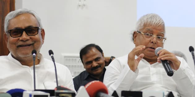 PATNA, INDIA - AUGUST 12: Bihar Chief Minister and JD(U) leader Nitish Kumar with RJD Chief Lalu Yadav addressing a joint press conference to announce Maha Gathbandhan on August 12, 2015 in Patna, India. The RJD and JD-U announced that they will contest 100 seats each in the Bihar assembly election, leaving 40 seats to the Congress and three to the NCP. (Photo by AP Dube/Hindustan Times via Getty Images)