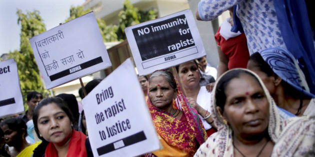 "Activists of All India Democratic Women's Association hold placards during a protest outside the Saudi Arabian embassy in New Delhi, India, Thursday, Sept. 10, 2015. Police in India were investigating complaints from two women that a Saudi Arabian diplomat raped them repeatedly and confined them in his home near New Delhi. He has claimed diplomatic immunity, and the Saudi embassy in a statement Wednesday denied all the allegations. Placard on top left reads, ""Punish the Rapist"". (AP Photo/Altaf Qadri)"